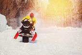 Snowmobile Races Jump In Snow Dust. Concept Winter Extreme Sports poster