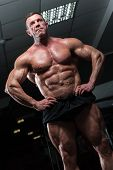 Mature Bodybuilder With Naked Torso Showing Sixpack Abdominal And Muscular Body. poster