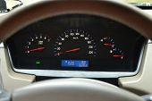 stock photo of speedo  - The automobile panel of devices kind through a wheel - JPG