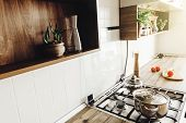 Cooking On Modern Kitchen  In Scandinavian Style. Stylish Grey Kitchen Interior Design With Modern F poster