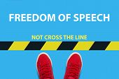 Legs In Red Sneakers On A Blue Background A Restrictive Yellow And Blak Stripe With Text Not Cross T poster