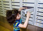 Waiting For Delivery. Little Boy, Smart Casual, At The Mailboxes Post, Checking The Mail poster