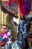 Beautiful Colorful Black Wooden Horse With Red Feathers On Head On Carousel Merry-go-round, Amusemen poster