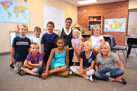 foto of student teacher  - Group of elementary school students and teacher - JPG
