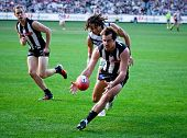 MELBOURNE - JUNE 30 : Steele Sidebottom attacks the ball during Collingwood's win over Fremantle on