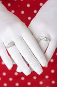 Woman Showing Hands Wearing Two Diamond Rings poster