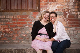 picture of queer  - Two girlfriends sitting outside at loading dock - JPG