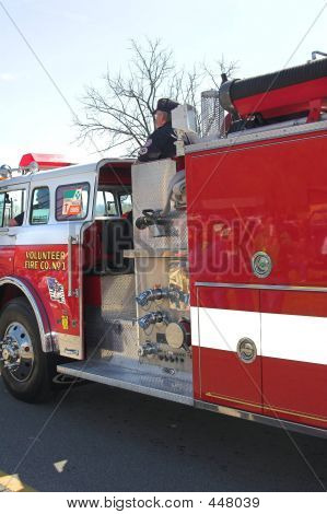 Picture or Photo of Closeup of fire truck ready to fight a fire, commanded by volunteers