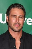LOS ANGELES - APR 22:  Taylor Kinney at the NBCUniversal Summer Pres Day 2013 at the Huntington Lang