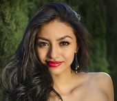 Beautiful young mixed race American woman with beautiful long hair, thick full lips