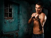 Horizontal Portrait Muscular Young Guy Street-fighter, Aggression Look, Over Wall