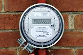 stock photo of power lines  - Residential hydro meter mounted on a house wall - JPG