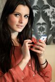 foto of long distance relationship  - Pretty young woman using mobile phone - JPG