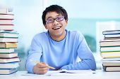 image of clever  - Portrait of successful Asian student sitting at workplace - JPG