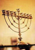 image of menorah  - Jewish menorah close-up against the blured background.