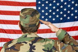 pic of army soldier  - A vetern soldier salutes his flag on Memorial Day - JPG