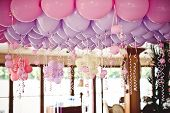 stock photo of wedding feast  - Pink balloons under the ceiling on the wedding party