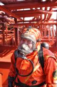 image of decontamination  - man in chemical suit on deck of chemical tanker - JPG