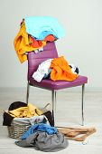 picture of sluts  - Heap of  clothes on color chair - JPG