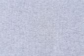 Light gray knitted fabric texture background.
