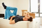 pic of flat-bed  - Man Moving Into New Home Talking On Mobile Phone - JPG