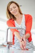 pic of homemaker  - Close Up Of Woman Washing Hands In Kitchen Sink - JPG