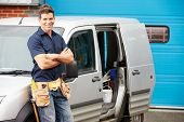 foto of electrician  - Plumber Or Electrician Standing Next To Van - JPG