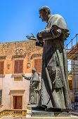 stock photo of gozo  - Sculptures of Pope John Paul II and Pius IX at the entrance of the Gozo Cathedral in Malta - JPG