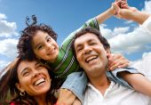 image of happy family  - happy family portrait outdoors smiling with a blue sky - JPG