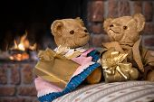 picture of cozy hearth  - Couple vintage teddy bears with christmas gifts in front of fireplace - JPG