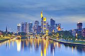stock photo of frankfurt am main  - Image of Frankfurt am Main skyline after sunset with the reflection of the city in Main River - JPG