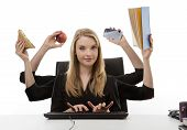 stock photo of multitasking  - busy business woman multitasking in the office with six arms - JPG