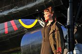 pic of bomber jacket  - retro portrait of a beautiful lady dressed in Canadian WWII uniform with a bomber aircraft - JPG