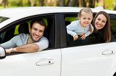 picture of car-window  - Family sitting in the car looking out windows - JPG