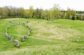 image of burial  - Large stone ship made of raised stones in Anundshog Sweden - JPG