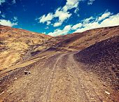 foto of himachal pradesh  - Vintage retro effect filtered hipster style travel image of dirt road in mountains  - JPG