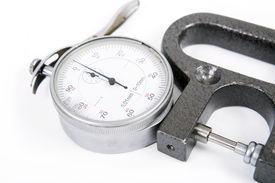 picture of micrometer  - micrometer with the round white dial white background - JPG