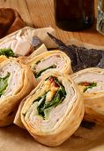 picture of sandwich wrap  - A turkey or chicken and cheese wrap sandwich with blue corn tortilla chips - JPG