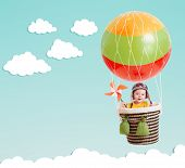foto of rafters  - cheerful kid on hot air balloon in the sky - JPG
