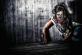 stock photo of bloody  - Furious bloody zombie girl - JPG