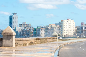 foto of malecon  - The famous malecon seawall in Havana vith a view of the city skyline - JPG