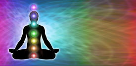 picture of quantum  - Rainbow matrix colored background with male silhouette in lotus position on left hand side with seven chakra vortexes positioned centrally - JPG