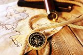 pic of spyglass  - Marine still life spyglass and world map on wooden background - JPG