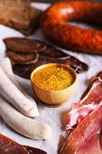 image of deli  - Assortment of deli meats on parchment background - JPG