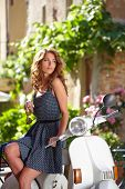 foto of scooter  - beautiful italian woman sitting on a italian scooter - JPG