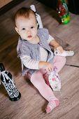 stock photo of decoupage  - child has fun sitting bottle - JPG
