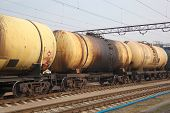 pic of railroad car  - Cargo train with oil tanker cars carrying the fuel on the railway track - JPG