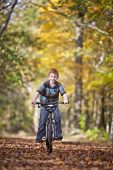 pic of bike path  - Young boy with bike on path during the autumn - JPG