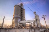 foto of silos  - Cement factory on sunset  - JPG