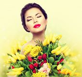 stock photo of woman  - Beauty model Woman with Spring Flower bouquet - JPG